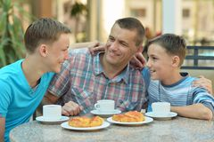 Father and sons having breakfast Royalty Free Stock Image