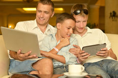 Father and sons with laptop Royalty Free Stock Image