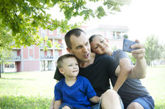 Father with sons makes selfie in a city Stock Image