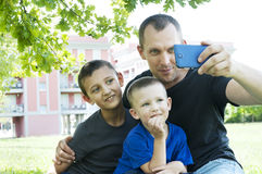 Father with sons makes selfie in a city Royalty Free Stock Images
