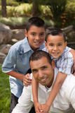 Father and Sons in the Park Stock Photo