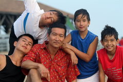 Father and sons portrait. Asian fathers bonds with his sons on a summer day on the beach Royalty Free Stock Photos