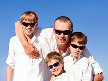 Father and sons walking on beach Royalty Free Stock Photos
