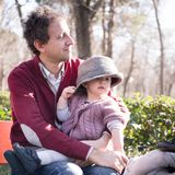 Father with cheerful child in the park. Royalty Free Stock Photo