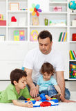 Father spending time with kids at home Stock Images