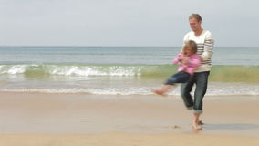 Father Spinning Daughter Around On Beach stock footage