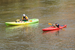 Father Squirts Son With Water Gun Kayaking Down Atlanta River Royalty Free Stock Photography