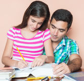 Father studying with his daughter Stock Photo