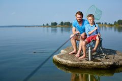 Father and Sun Enjoying Fishing Together Stock Photos