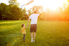 Father and sun holding hands running royalty free stock photography