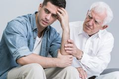 Father supporting his despair son Royalty Free Stock Photography