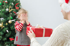 Father surprising little girl. With christmas gift Stock Photos