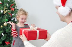 Father surprising little girl. With christmas gift Stock Image
