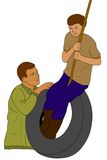 Father Swinging Son. A father pushing his son on a tire swing. Father's Day.  Spending quality time with son Royalty Free Stock Photography