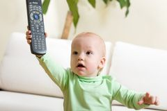 Father switch on a TV, please! Royalty Free Stock Photo