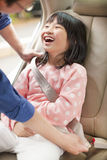 Father take care daughter to fasten a seat belt Royalty Free Stock Image