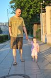 Father takes child for walk Stock Photography