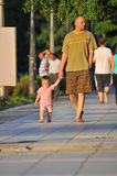 Father takes child for walk Stock Photo
