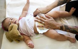Father is taking care of his child. Royalty Free Stock Image