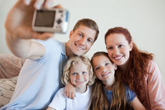 Father taking a family picture Royalty Free Stock Images