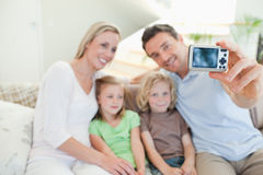 Father taking family picture on couch Royalty Free Stock Photo