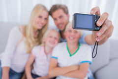 Father taking family picture. In the living room Royalty Free Stock Photos