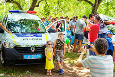 father taking photo of his children  near new Ukrainian police car Royalty Free Stock Image