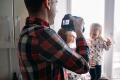 Father taking photo of his daughter and wife Royalty Free Stock Photo