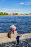 A father taking photos of his children in Saint Petersburg. Royalty Free Stock Photography