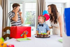 Father Taking Picture Of Birthday Boy And Woman Stock Photo