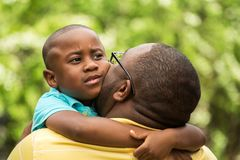 Father talking to his son. African American loving father guiding his son Stock Photo