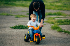 Father teach his young son to drive a bicycle Royalty Free Stock Photo