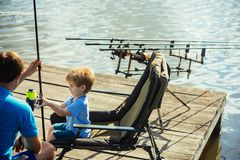Father teach small son to fish in freshwater royalty free stock photo