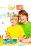 Father teach son to draw Royalty Free Stock Image
