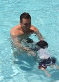 Father teach son to swim Stock Photo