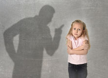 Father or teacher shadow screaming angry reproving young sweet little schoolgirl or daughter. Father or teacher shadow screaming angry reproving misbehavior to royalty free stock images