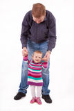 Father teaches his small daughter to walk Royalty Free Stock Photography
