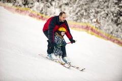 Father teaches his son to ski, Ukraine, Transcarpathia, Royalty Free Stock Images