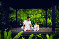 Father teaches son to find inner balance Royalty Free Stock Photos