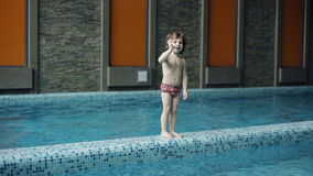 Father teaches son to swim in the pool. stock video footage
