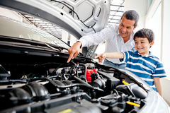 Father teaching car mechanics Stock Photos