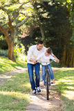 Father teaching daughter bike Stock Photos