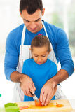 Father teaching daughter cooking Stock Photography