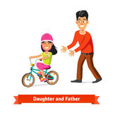 Father teaching daughter to ride a bicycle. Flat style vector illustration Stock Image