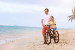 Father teaching daughter to ride bike Royalty Free Stock Image