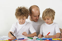 Father teaching his children stock photo