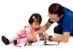 Father teaching his daughter Stock Image