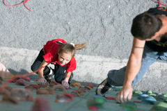 Father teaching his little baby daughter rock climbing Stock Images
