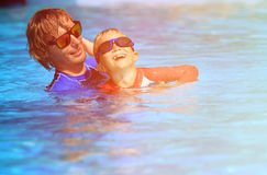 Father teaching his little son to swim Stock Photography