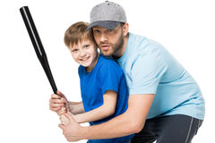 Father teaching his son how to play baseball. Isolated on white Stock Photography
